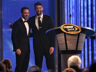 Michael Phelps surprises Jimmie Johnson with banquet introduction